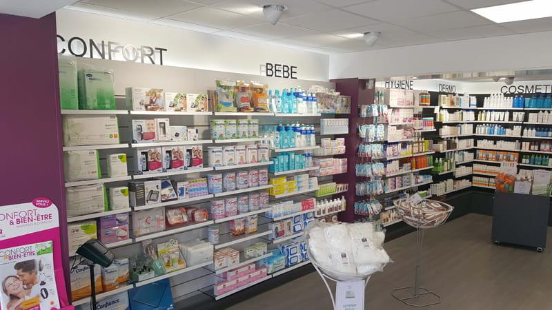 Aménagement d'une pharmacie à May-sur-Orne avec la création d'espaces : bébé, confort, hygiène, dermo, cosmétique