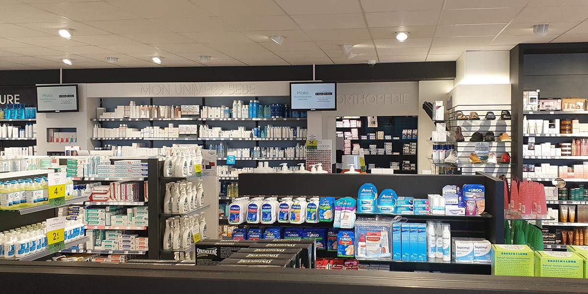 Réalisation de la signalétique interne d'une pharmacie à Louvigny.